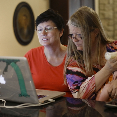 Mother with baby looking at laptop