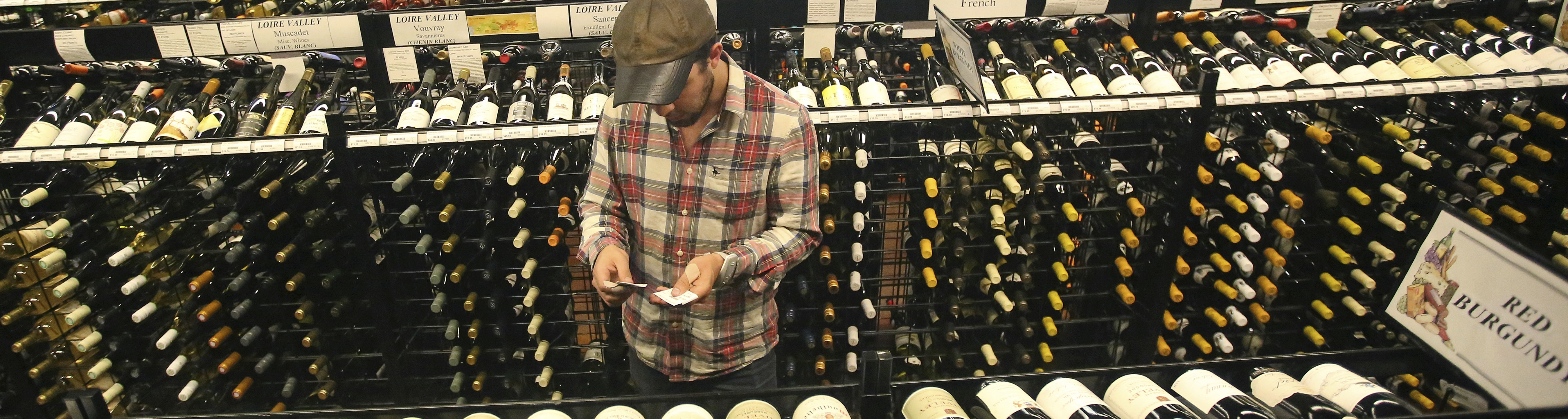 A worker at a state liquor store